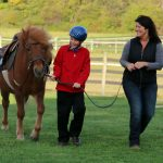 Fieldstone farm volunteer with student and horse